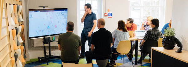 A team at Cambridge Intelligence working together to solve a data visualization challenge