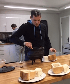 Scott serving up traditional South African bunny chow for his teammates