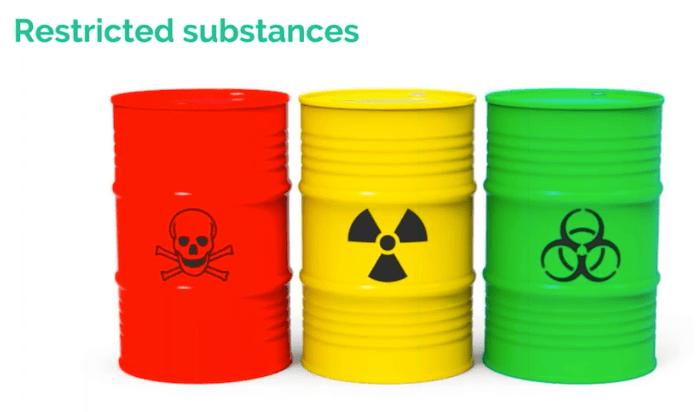 Three brightly-colored barrels of hazardous materials